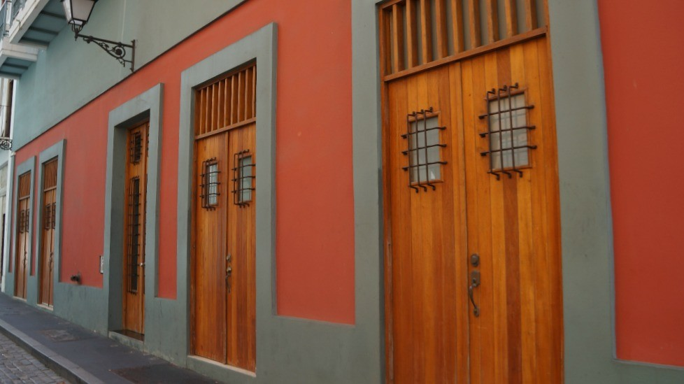 Wooden doors on an orange building, San Juan, Puerto Rico