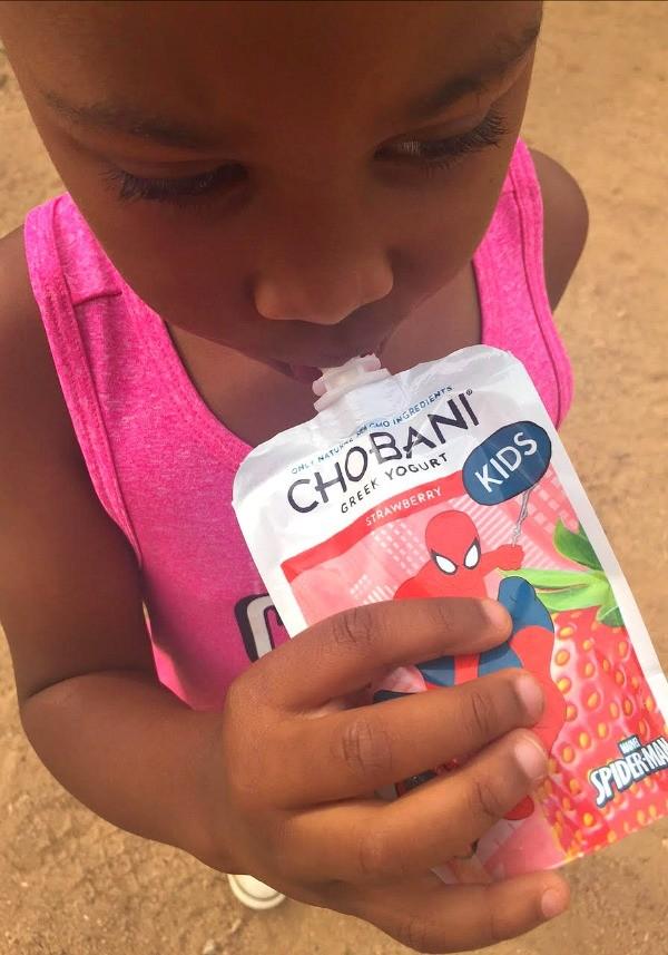 Little kid eating Chobani Kids Greek Yogurt Pouch